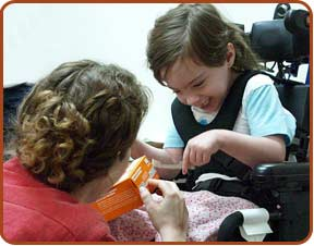 disabled child pointing to cookie box